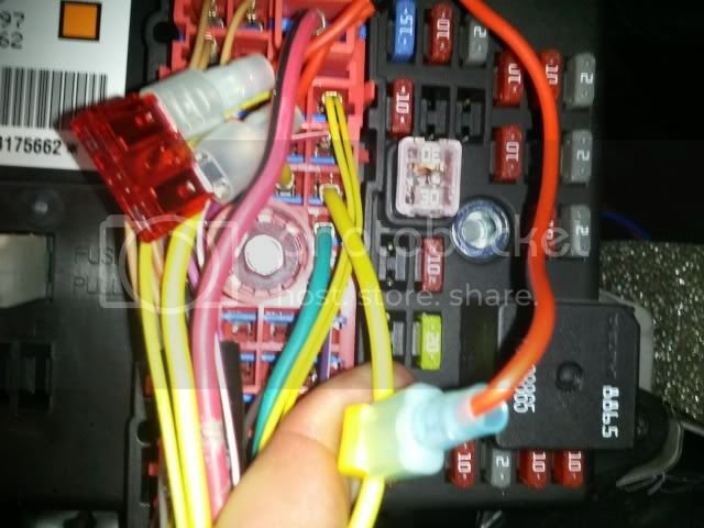 the wire is made up with a 10 amp fuse and attaches to the red ignition wire  on the cd player harness  see below for the wire